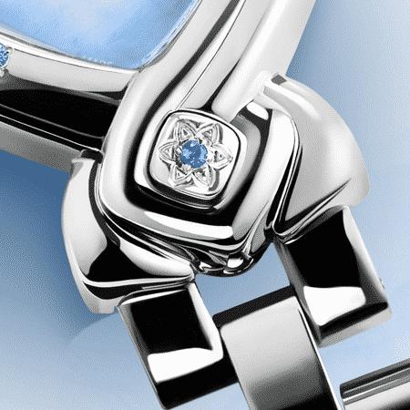Elegante feminine Uhren für Damen: Ashta Laxmi: Stahlduhr mit 7 Saphiren, Zifferblatt Perlmutter blau, vernickelte Hände, Stahlcabochon mit Saphir, PerlmutterArmband aus Stahl.