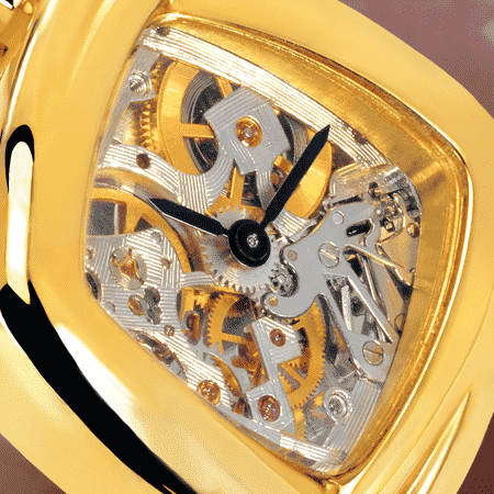 skeleton watch for women - Dentelle cascade dorée: Mechanical gold watch (Piguet movement), black hands, gold cabochon with a ruby, yellow gold cascade bracelet
