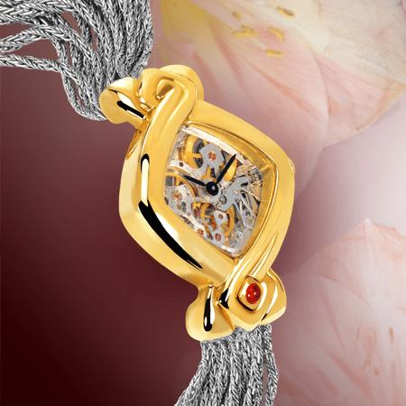 Armbanduhren mit Skelettuhr für Damen: Dentelle cascade givrée: mechanische Golduhr (Piguet Werkzeug), schwarze Hände, Goldcabochon mit einem Rubin, Goldarmband Cascade weiss