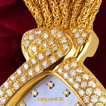 Schmuckuhr für besondere Frauen: Diva blue: Golduhr mit 141 Diamanten, Zifferblatt Perlmutter blau mit 12 Diamanten, vergoldete Hände, Goldcabochon mit une spinelle rose, Goldarmband Cascade