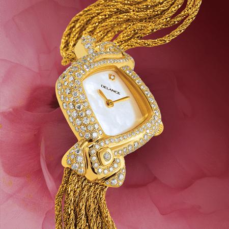 Eclat de rire : Montre de luxe en or sertie de 242 diamants, cadran nacre blanche, aiguilles dorées, cabochon en or avec un diamant à 6h, bracelet en brins d'or