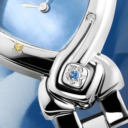 Damenuhren Eleganz für Frauen: Feng Shui Ocean: Stahlduhr mit 8 Edelsteine, Perlmutter blau, vernickelte Hände, Stahlcabochom mit einem Saphir , Armband aus Stahl