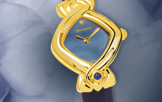 best watches for mom - May: Gold watch set with 6 diamonds, blue mother-of pearl dial, gold-plated hands, gold cabochon with a sapphire, azur sateen strap