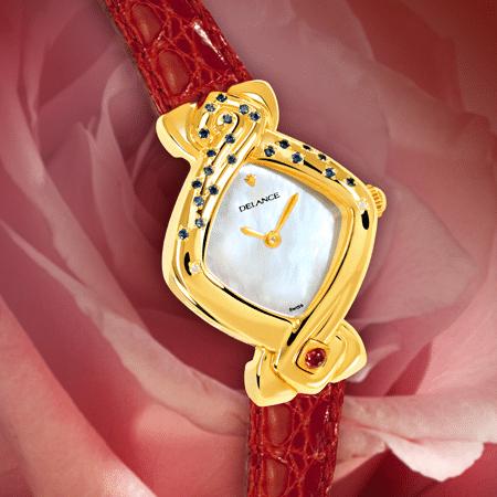 Micheline : anniversaire montre en or sertie de 2 diamants et 22 saphirs, cadran nacre blanche, aiguilles dorées, cabochon en or avec un rubis, bracelet en alligator rouge vin
