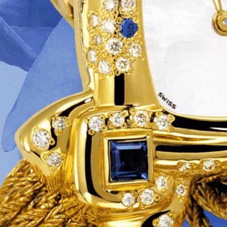 Schmuckuhr für besondere Frauen: Aïda: Golduhr mit 64 Diamanten et de 2 Saphiren , Zifferblatt Perlmutter weiss, vergoldete Hände, Goldcabochon mit Saphir, Goldarmband Cascade.