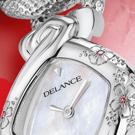 Elegante originelle Damen Uhr: Kanon acier: Stahlduhr mit 3 Blumen und 3 rosa Saphiren , Zifferblatt Perlmutter weiss, Stahlcabochon mit einem Diamanten, Armband aus Silber