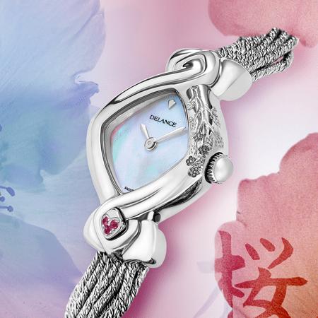 Miva acier : Montre en acier gravée à la main d'une branche de cerisier, cadran nacre blanche ou rose, aiguilles nickelées, cabochon en acier avec 3 saphirs roses à 6h, bracelet en brins d'argent