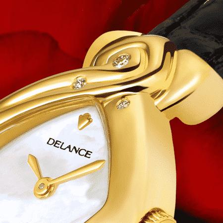 Damenuhren Eleganz für Frauen: Yin Yang: Golduhr mit 4 Diamanten und einem blauen Saphir, Zifferblatt Perlmutt weiss, vergoldete Zeiger, Goldcabochon mit einem Rubin, Armband aus Alligatorleder schwarz