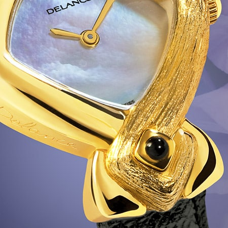 The smooth side of the gold case expresses her femininity and her gentleness, while the textured side reflects her determination